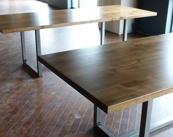 Modern dining table, with walnut stain and steel base