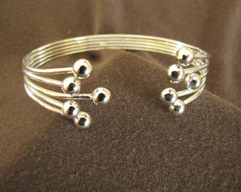 Sterlling Silver Open Front Balls Bangle