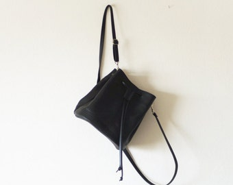 Mini convertible black leather bucket bag crossbody and backpack