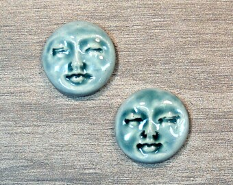 Pair of Two Medium Round Ceramic Face Stone Cabochons in Peacock