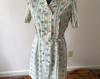 60s floral dress with double breasted buttons and belt / A Dixie Lou Frock
