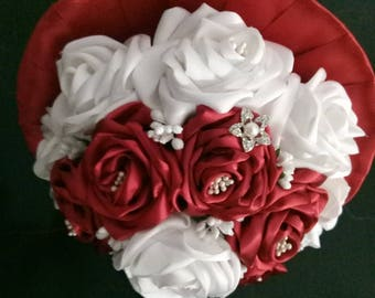 Hand made bridal bouquet of flowers made of sateen,pearls and zircon.Arranged this way the bouquet has refined style and classic elegance