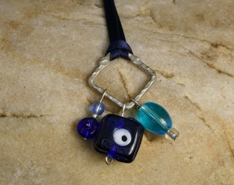 Blue and silver bead pendant with navy blue ribbon