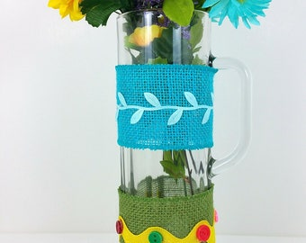 Burlap glass mug turquoise and green wrap with yellow and blue flowers 102