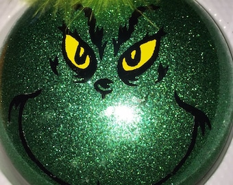 Grinch glittered Christmas Ornament can be personalized