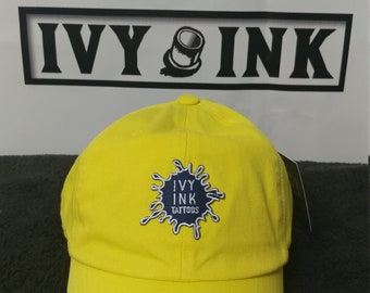 Bright yellow Ivy Ink (Ink Blot) dad hat