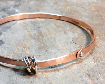 Copper bangle with silver rivet and silver tangle bead by VisionQuest