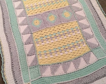 Sweet crocheted baby blanket in yellow, green, grey and white by KnottedwLove.
