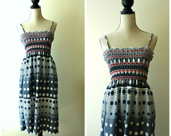 Adorable vintage red, white and blue polka dot ombre spaghetti strap sundress.