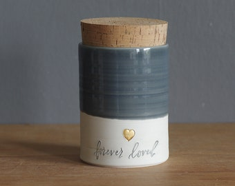 ready made urn. white porcelain clay pottery urn with slate grey glaze and gold heart