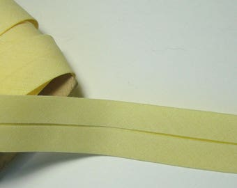 Cotton bias tape, 20 mm, yellow, sold by the yard.