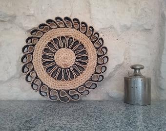 Below flat round trivet Vintage, woven natural fiber, straw or raffia - Bohemian decor / vintage