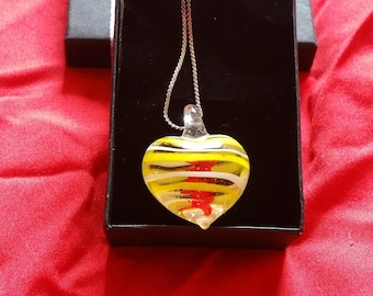 Yellow and red swirled heart pendant on silver chain