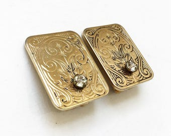 vintage art nouveau inspired gold tone metal mildly distressed rectangular clip on earrings with colorless rhinestone embellishment