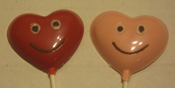 One dozen Heart lollipops with smiley faces