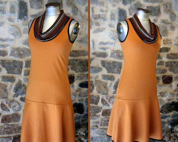 Promo Studio space. Orange-Tan, Tan stripe collar dress. Creative women Jersey cotton dress