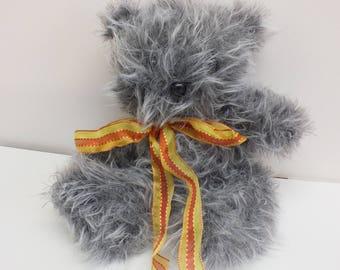 Grey fake fur teddy bear