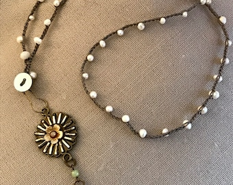 "32"" Ivory freshwater pearl necklace with unique flower pendant with green accents"