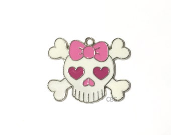 1 Enameled Large Girly Skull and Crossbones Pendant with pink hearts and pink bow. 2 inches x 1 5/8 inches Monster Doll craft or party favor