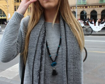 Black and Blue Beaded Tassel Necklace.
