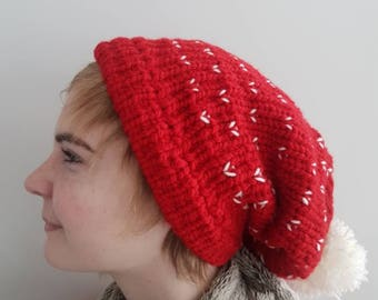 Red and white knit slouchy pom pom hat