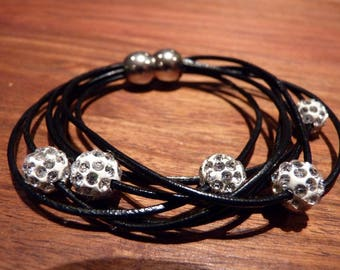 Beautiful bracelet leather and white glitter beads