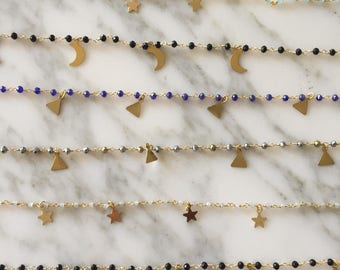 Rosary choker with triangles, stars or moons.