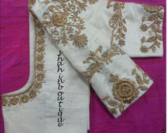 Attractive White blouse with gold floral threadwork silk saree Blouse