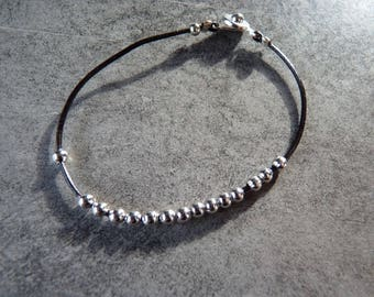 Small leather strap and silver beads