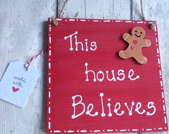 Christmas plaque sign ...This house believes...size 15 x 15cm with cute gingerbreadman