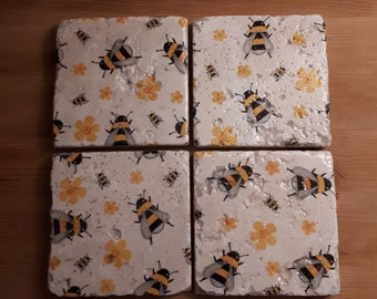 A set of four natural stone tile coasters
