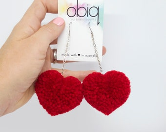 red heart shaped pom pom earrings - statement earrings!