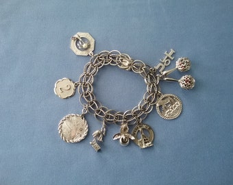 Vintage Sterling Silver Charm Bracelet with 9 charms