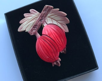 Vintage celluloid hat flash or lapel pin c.1930s - rosehips or berries
