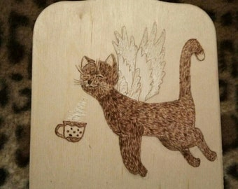 woodburning for the kithen cat with cup cat with cutting board