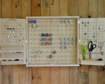 Wall cabinet in solid wood for reels cans and accessories, sewing workshop