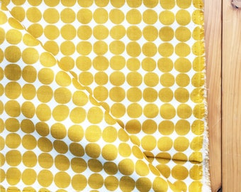 japanese fabric. solid cotton double gauze. polka dot pattern. 108cm (42.5in) wide. sold by 50cm (19in) long / half yard. mustard yellow.
