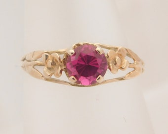 Ladies Round Cut Red Birthstone 10K Yellow Gold Ring