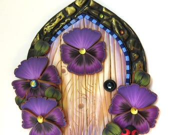 Purple Pansies with a Ladybug Fairy Door by Claybykim Pixie Portal Polymer Clay Miniature Door for Fairy Gardens and Home