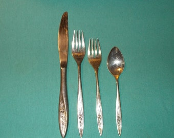 One (1), Four Piece Place Setting from Community Oneida, in the Morning Rose Pattern.