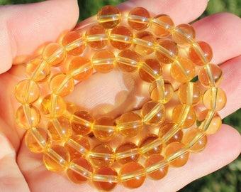 4 Citrine 8 MM round beads.