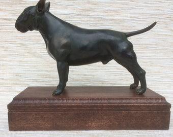 English Bull Terrier bronze sculpture with black patina finish on English oak.