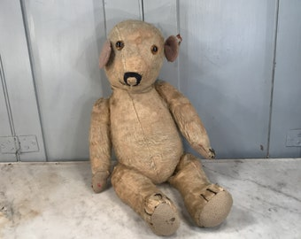 Antique straw filled teddy bear