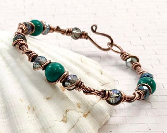 Copper wire wrapped bracelet featuring jasper and glass beads.