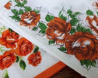 Two vintage floral printed handkerchiefs Orange floral print on white cotton Mixed pair