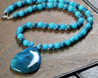 Quartz and Crazy Lace Agate Necklace with a Blue Agate Pendant