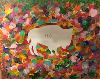A colorful collage sets the background for a white Buffalo
