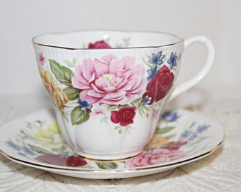 """ROYAL ALBERT """"Somerset"""" Teacup and Saucer Large Full Roses Across Cup and Saucer in Red,Pink,Yellow,Blue"""