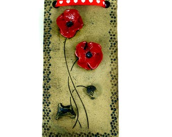 Red Poppy Wall Tile with Heart Ribbon by Maggie Betley - Zoo Ceramics - Slab Built + Hand Carved Original British Pottery Plaque Design
