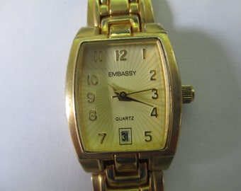 "Vintage lady's date watch ""Embassy"" gold tone metal band 7""  used watch"